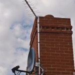 Compact chimney installation of aerial and satellite dish